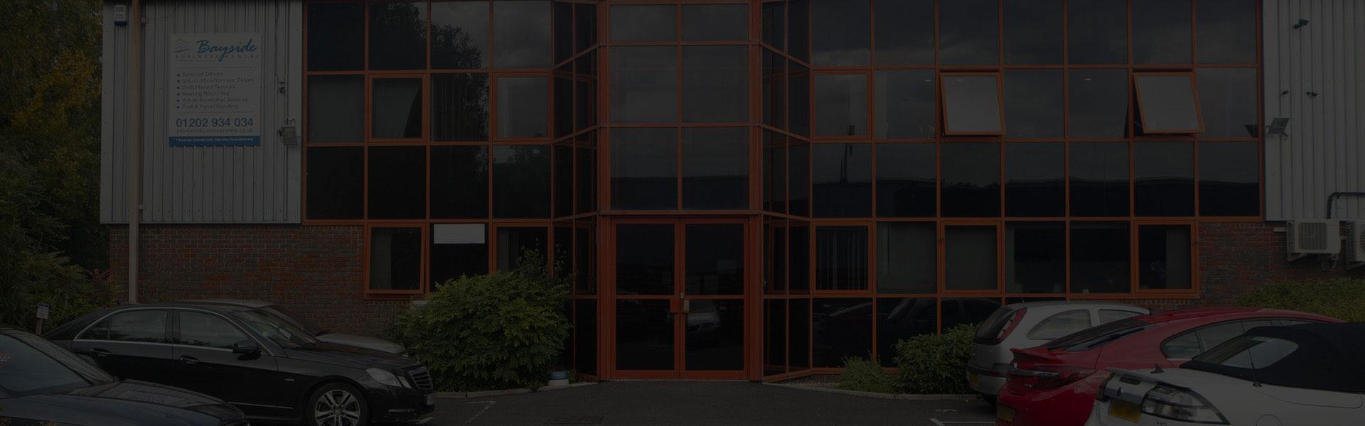 offices-exterior-dimmed-slide